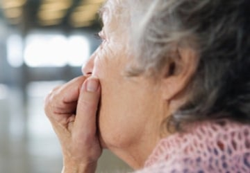 Photo of an older person looking thoughtful