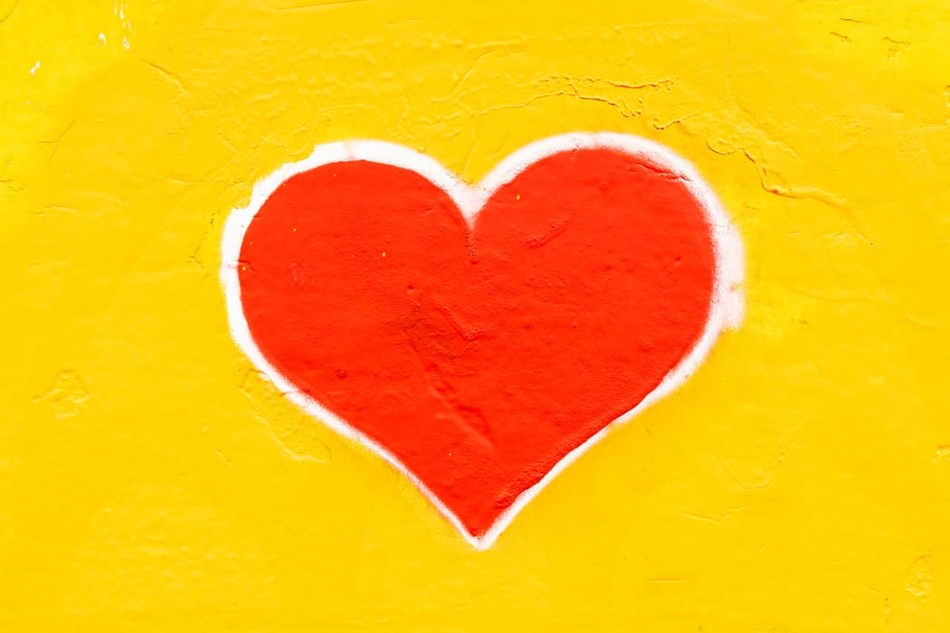 Painting of a heart on a wall.