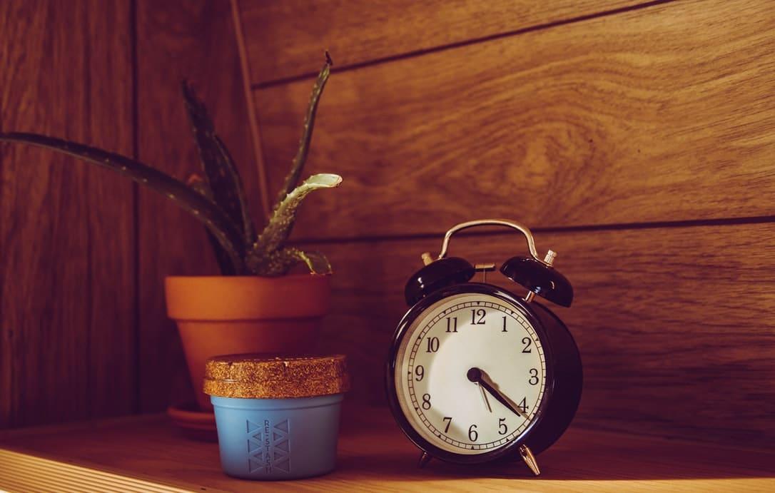 An alarm clock on a shelf.